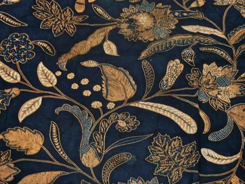 hand dyed indonesian batik featuring a royal blue background with gold flowers