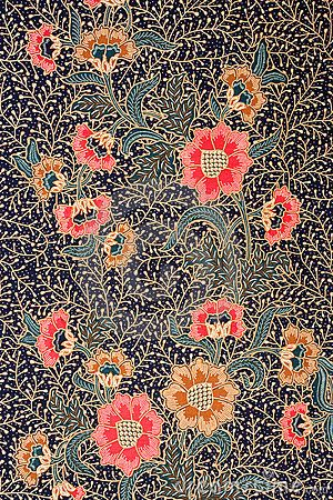 traditional batik design featuring a royal blue background with white, yellow, and pink flowers