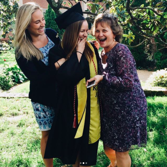 college graduation with mother and two daughters